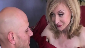 The best sex escorted by big tits granny Nina Hartley