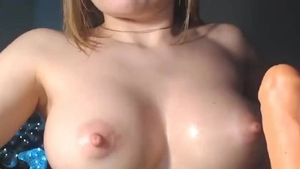 Busty female playing with toys live on webcam solo