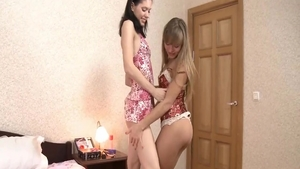 Teen lesbian rub their clits together